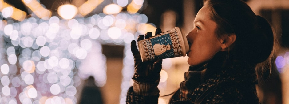 Lady enjoying a warm drink at the Oxford Christmas Market