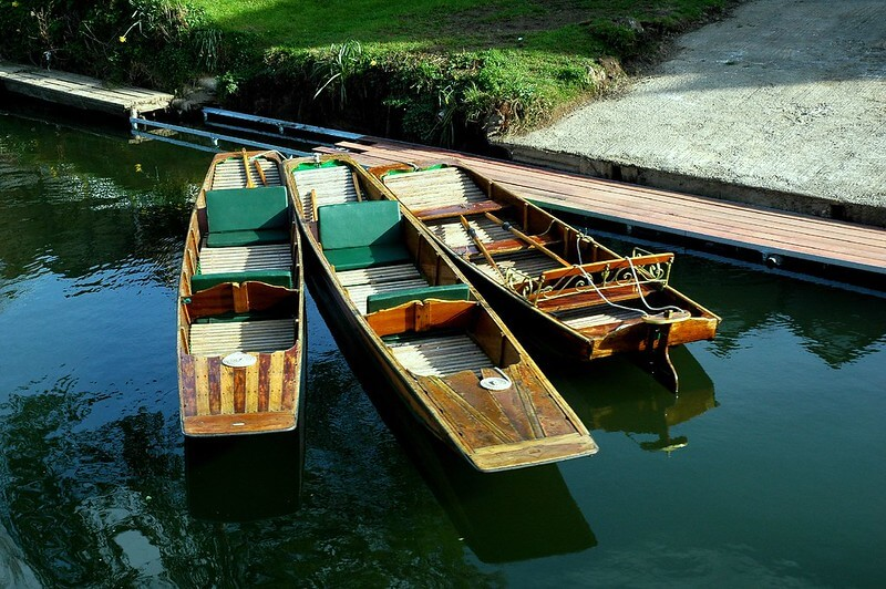A photo of three punts (boats) by the banks of the River Avon in Bath