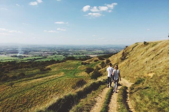Two people walking the Cotswold Way