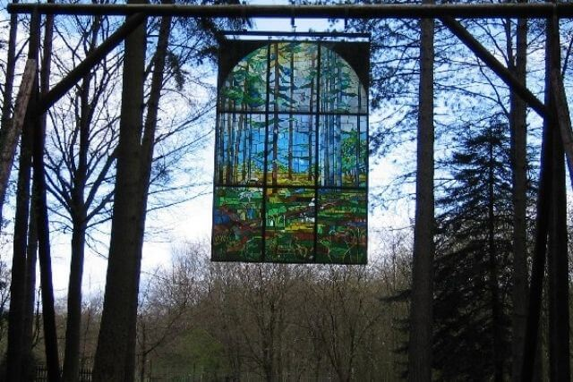 The Cathedral, stained glass window suspended in the iar along the Sculpture Trail.